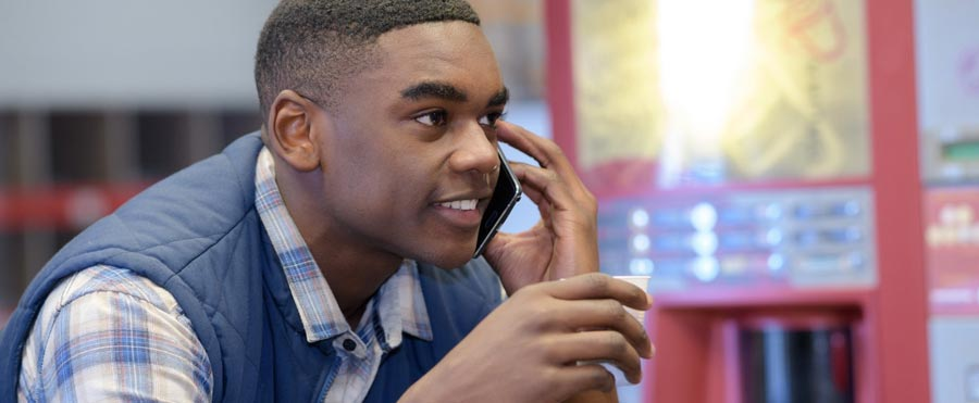 Man using a business telephone service